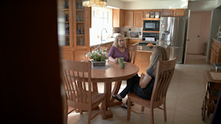Two women are talking over coffee in a kitchen thumbnail