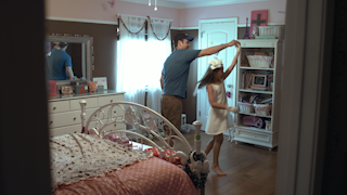 A father dances with and spins his young daughter in her room thumbnail