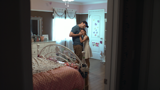 A father spins and dances with his young daughter in her room thumbnail
