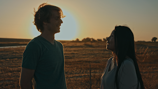 A couple is laughing together at sunset thumbnail