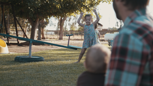 A little girl jumps up and down in her backyard thumbnail