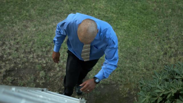 A man is climbing up a ladder thumbnail
