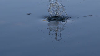Water is rippling in a blue pond thumbnail