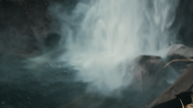 A waterfall crashes down into a rocky river thumbnail