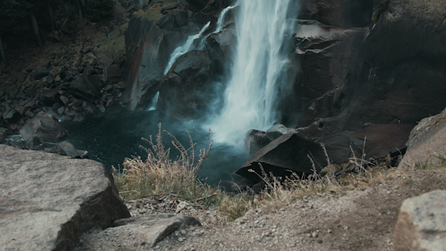 A waterfall flows down into a rocky pool thumbnail