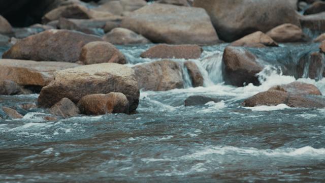 A river flows through rocks thumbnail