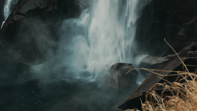 A waterfall flows into a rocky pool thumbnail
