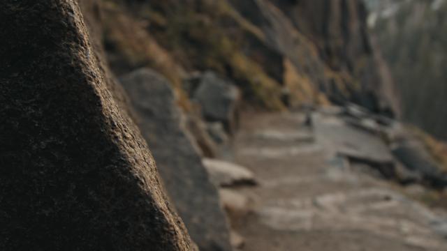 A rocky hiking path along a ravine thumbnail
