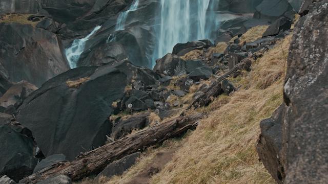 A waterfall flows into a rock filled terrain thumbnail
