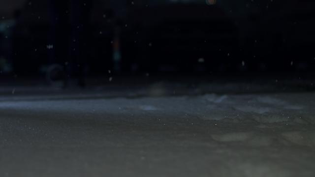 A person walks through snow thumbnail