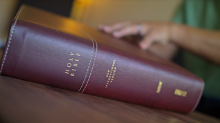 A man opens the bible thumbnail