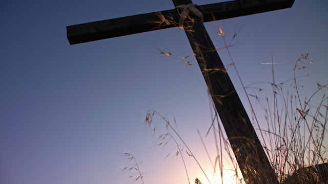 A cross against a sunset sky thumbnail