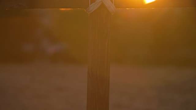 A sihlouetted wooden cross at sunset thumbnail