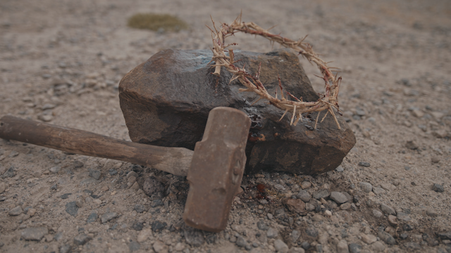 A crown of thorns on a rock next to a hammer thumbnail