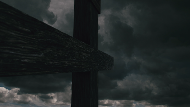 A cross stands beneath a dark cloudy sky with lightning thumbnail