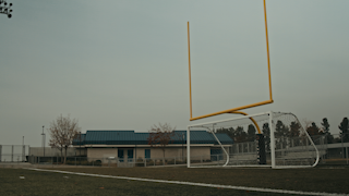 Goal posts on a high school football field thumbnail