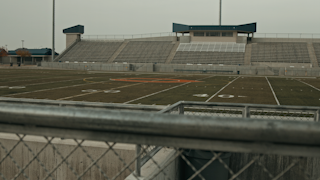 Bleachers at a high school football stadium thumbnail