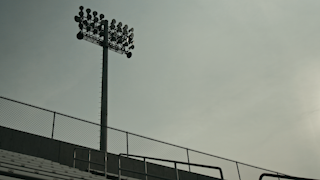 Stadium lights at a high school football field thumbnail