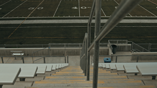 Bleachers and stairs at a high school football stadium thumbnail