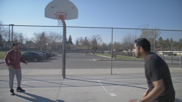 Two friends are playing basketball thumbnail