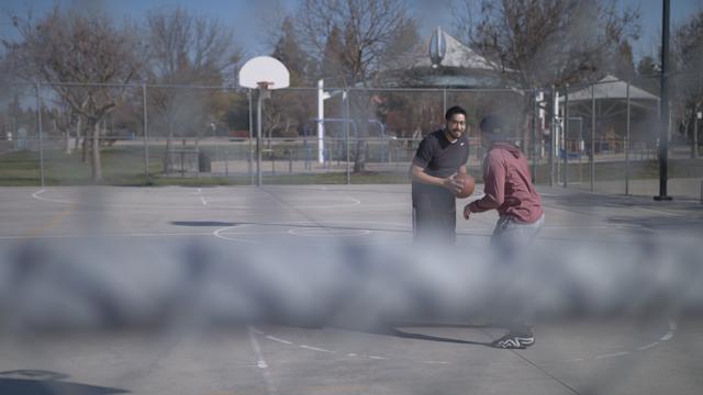 A man dribbles a basketball and takes a shot thumbnail