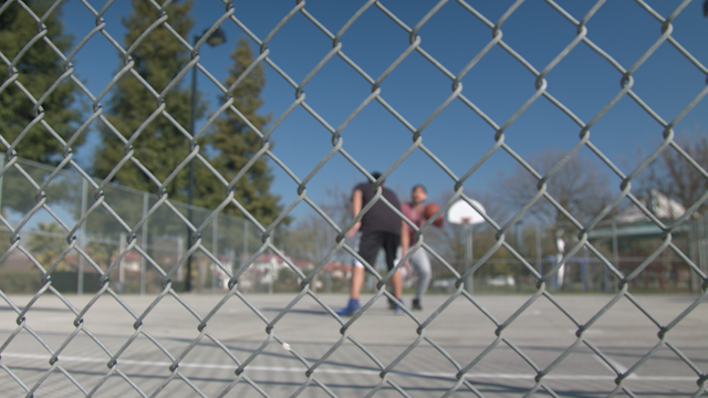 Two friends are playing basketball together thumbnail