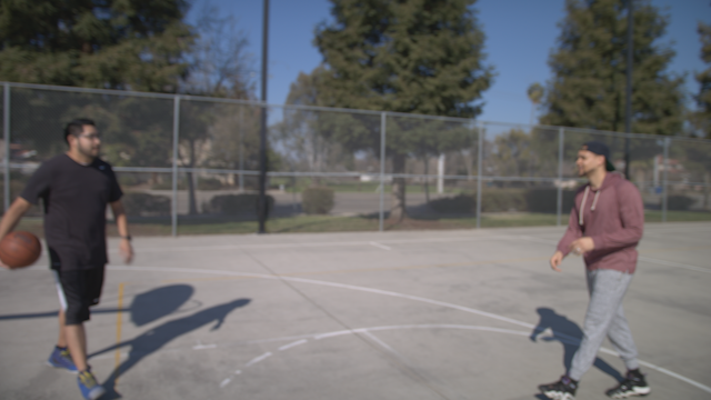 Two friends talk after shooting hoops thumbnail