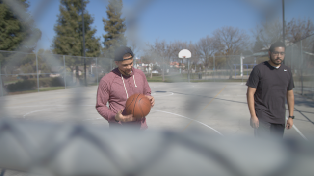 Friends are talking as they leave a basketball court thumbnail