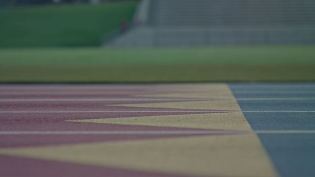 A runner gets into position on a track thumbnail