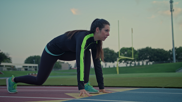 A runner takes off running on a track thumbnail