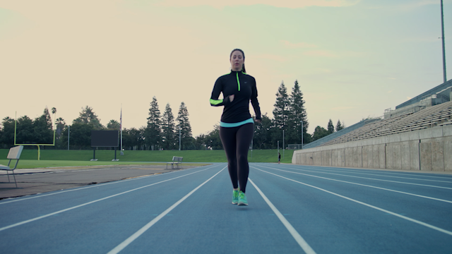 A woman is running down a track in the morning thumbnail