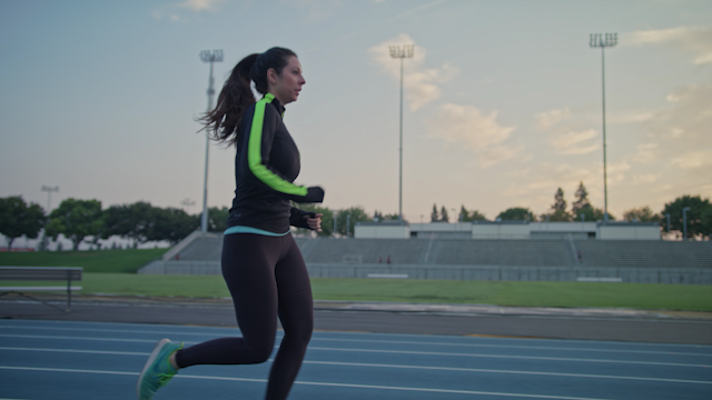 A runner runs down a track in the morning thumbnail