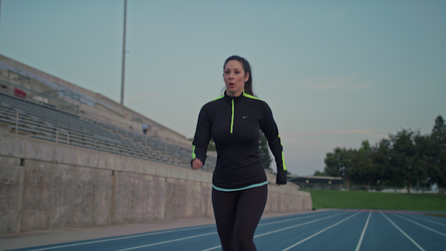 A runner is jogging down a stadium track in the morning thumbnail