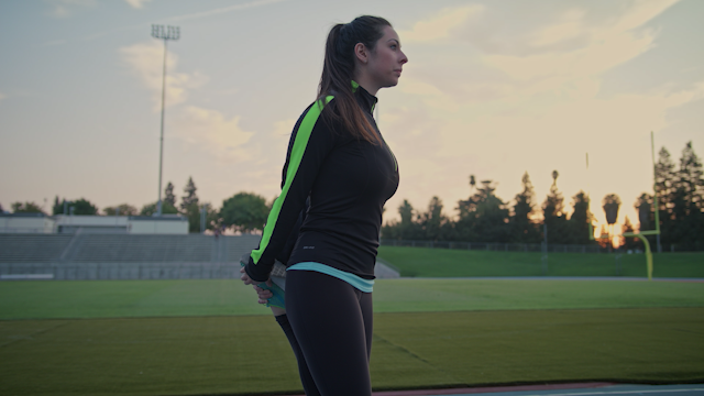 A woman stretches out on a track in the morning thumbnail