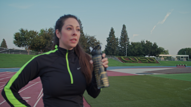 A runner drinks out of a water bottle thumbnail