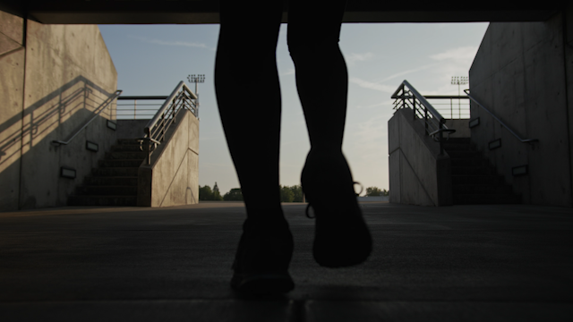 A woman walks into the daylight in a stadium thumbnail