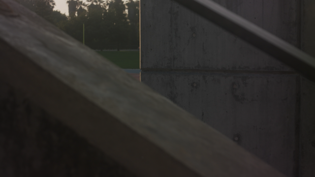 A woman walks out into the morning light in a football stadium thumbnail