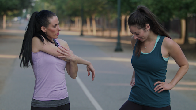Two women talking while warming up on a path thumbnail