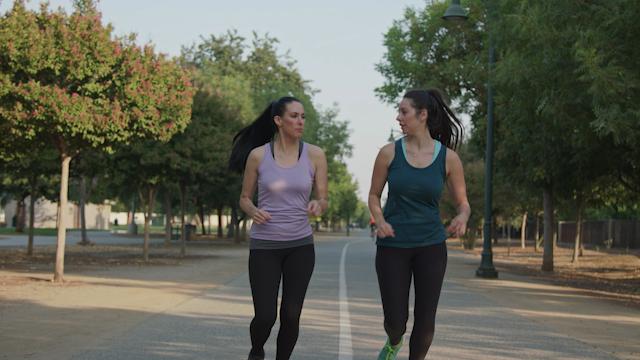 Friends jog down a paved path thumbnail
