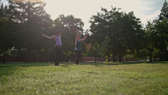 Two women are jumping rope in a park during the morning thumbnail