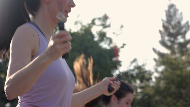 A woman is jumping rope in a park thumbnail