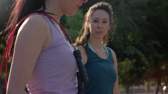 A woman grabs a jump rope and begins to exercise thumbnail