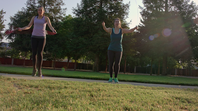 Two women jumprope together in a park thumbnail