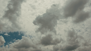 Clouds are formulating and rolling by in a timelapse thumbnail