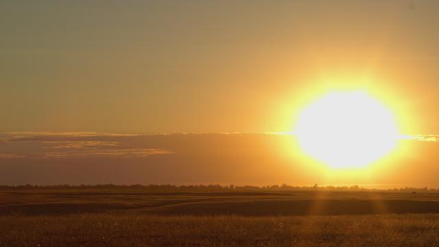 The sun sets into a cloudy horizon thumbnail