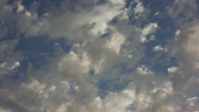 Clouds roll swiftly through the sky thumbnail