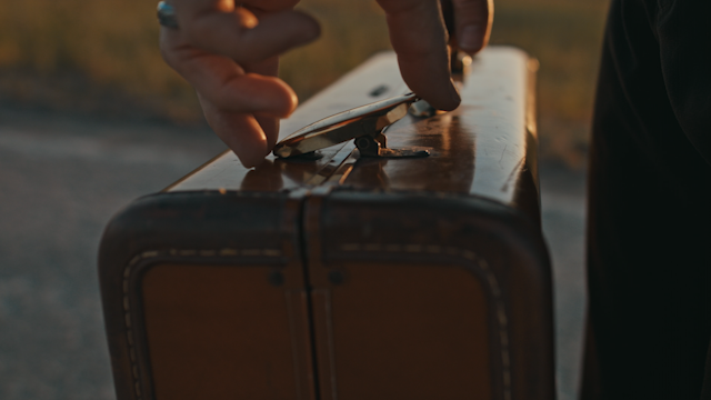 A suitcase is unclasped and falls open thumbnail