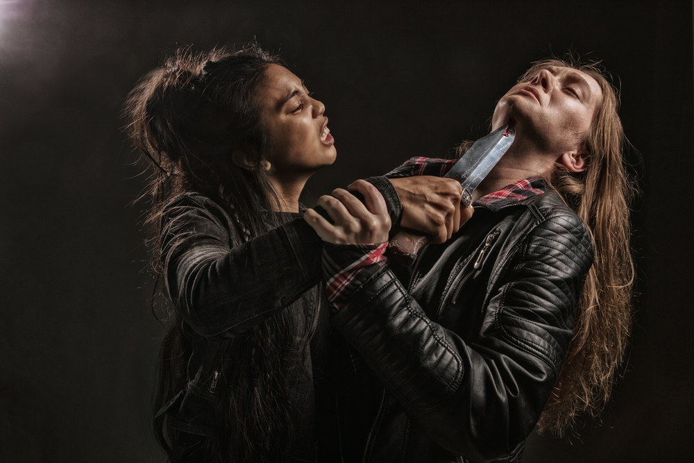 two female vancouver actors and stage combat specialists perform for a photo shoot showing a street fight scene