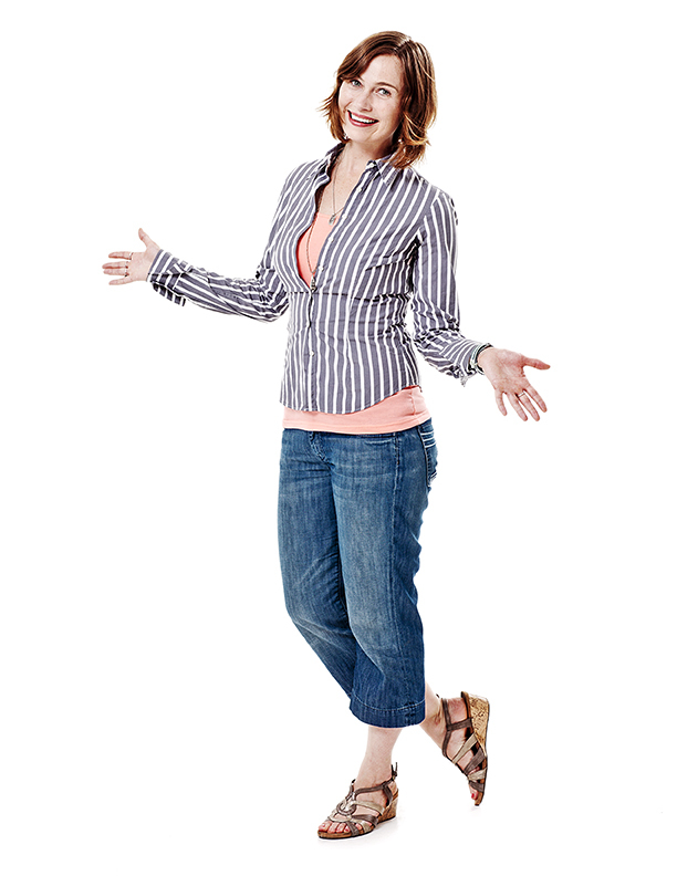 comedic photograph of a smiling woman shot against a white background in Toronto Canada