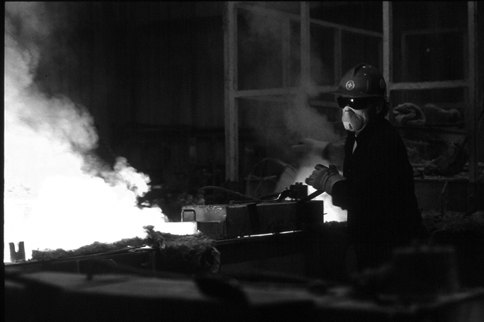 Dramatic Black & White shot of a steelworker in a foundry.